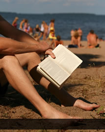 man reading at the beach